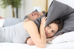 husband snoring loudly and wife frustrated-mattress360